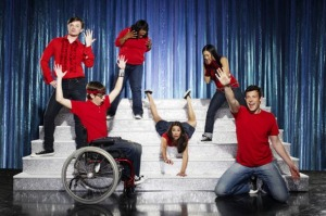 Lea Michelle (center on stairs) will appear at the Hollywood Reporter/Billboard Film and TV Music Conference. Glee cast pictured (L-R): Chris Colfer, Kevin McHale (seated), Amber Riley, Lea Michele (center), Jenna Ushkowitz, Cory Monteith.(Photo: FOX/Matthias Clamer)
